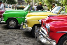 Red, yellow, and green vintage cars in Cuba