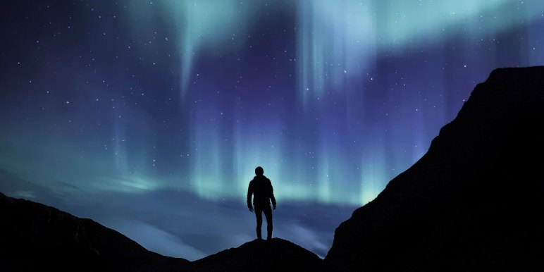 Solo traveler enjoying the northern lights