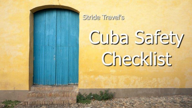 Blue door against yellow building in Cuba