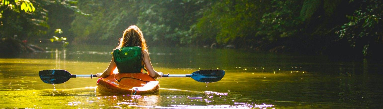 Young woman enjoying a kayaking trip in Drake Bay, Costa Rica