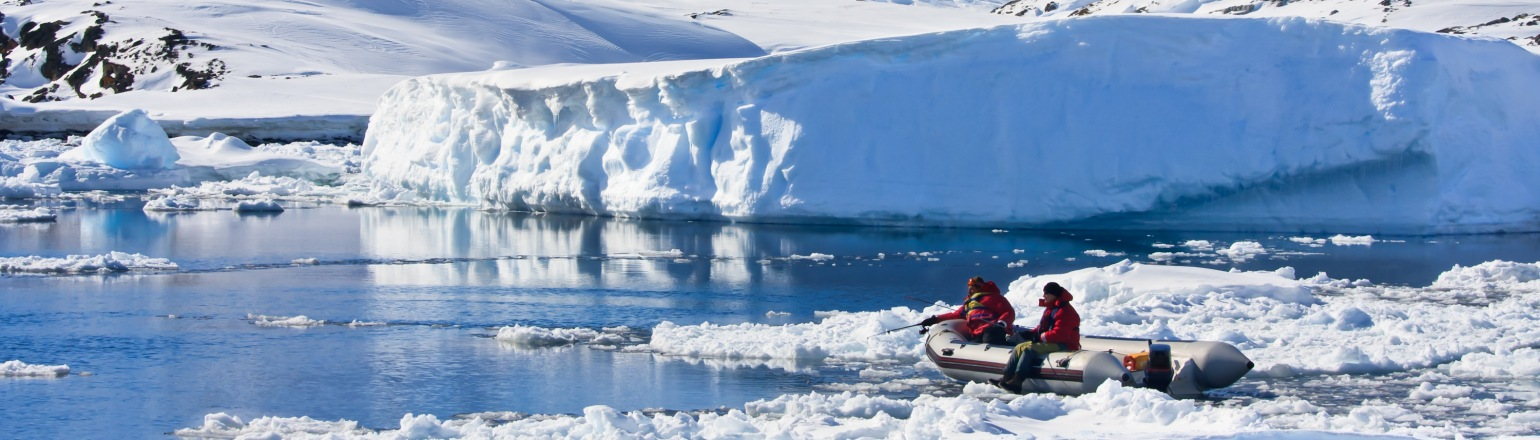 Sunny day in Antarctica, zodiac tour among small icebergs