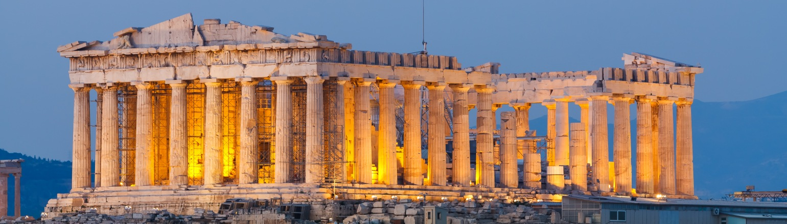 Greek ruins lit up at night history tour attraction