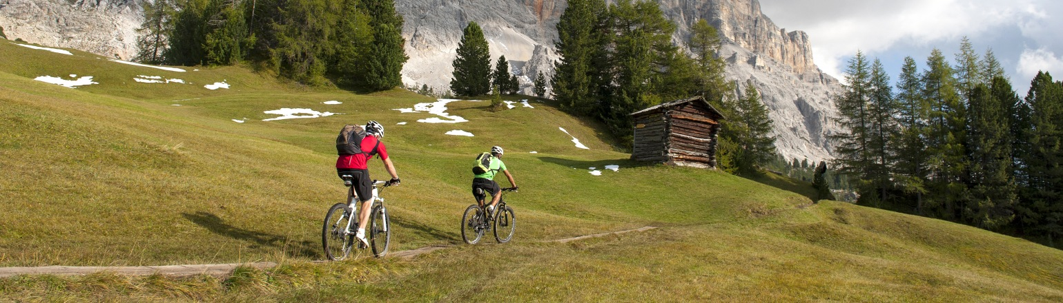 Guided Bike tour in mountains two cyclists