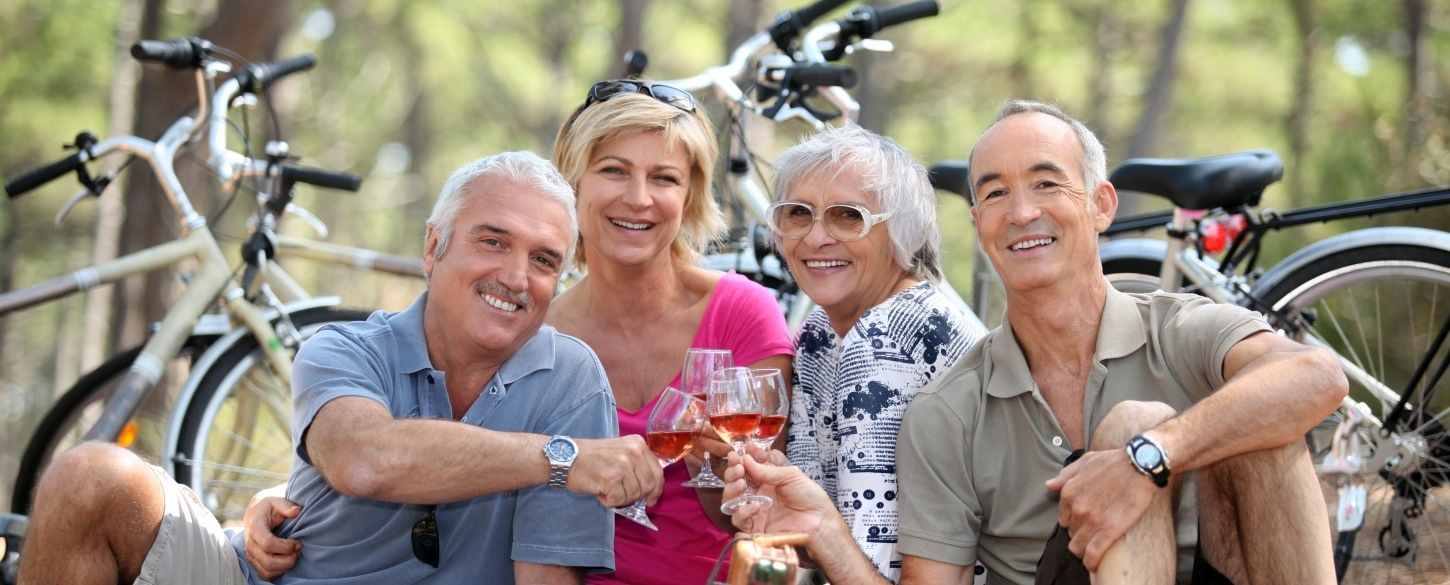 50-Plus tour group enjoying wine tasting after cycling
