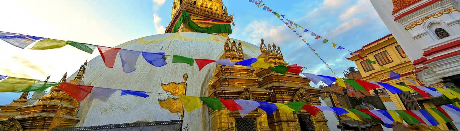 Temple with prayer flags, top Nepal tour attraction