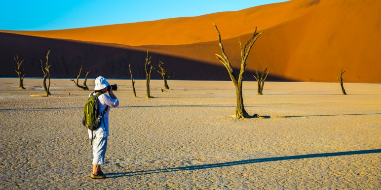 Traveling taking photographs in Namibia