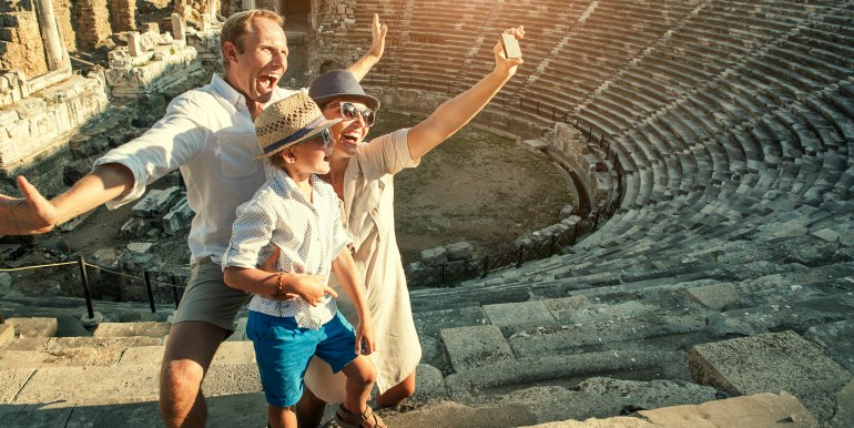 Happy family taking a selfie in Rome