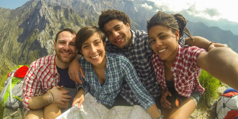 Young group of friends traveling in the mountains