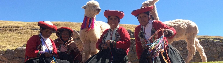 Peruvian women in traditional dress with llama