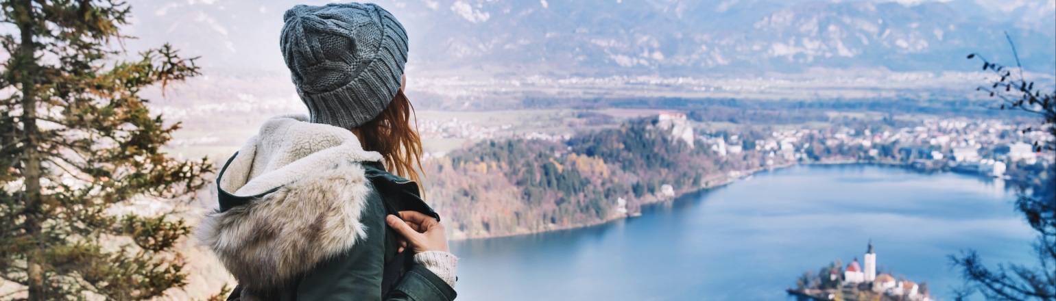Young solo traveler woman hiking on guided trip in Europe