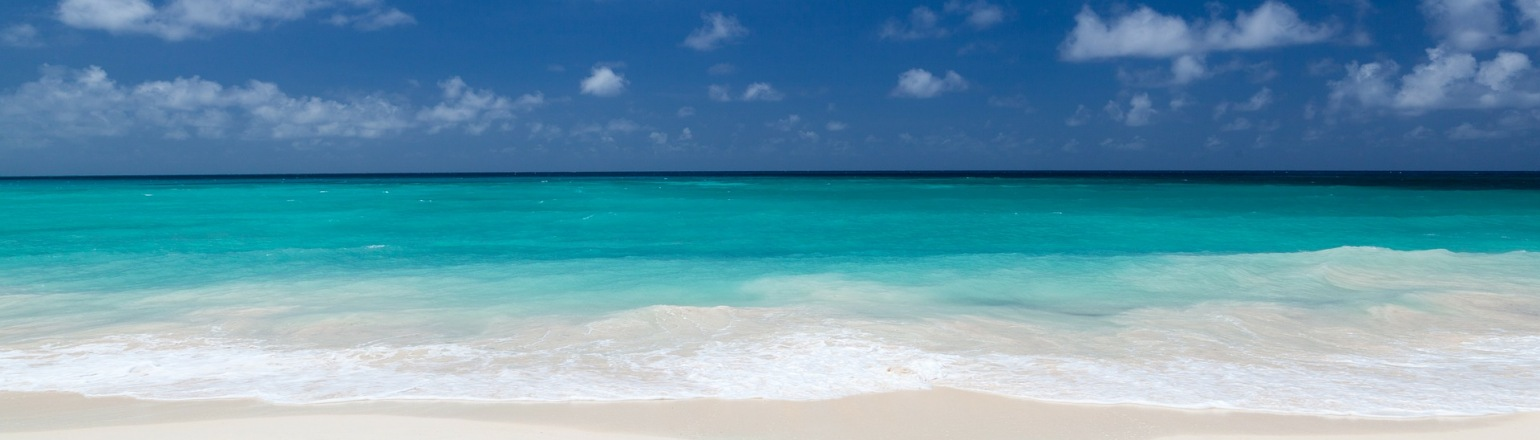 Incredible white sand beach and clear blue water in Belize