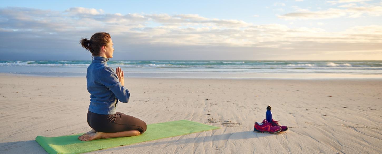 Beach yoga at sunrise top Yoga Tour activity