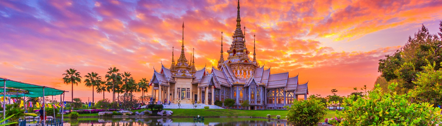 Bright orange and pink sunset over Wat None Kum temple in Thailand