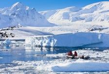 Two men in zodiac on Antarctica tour