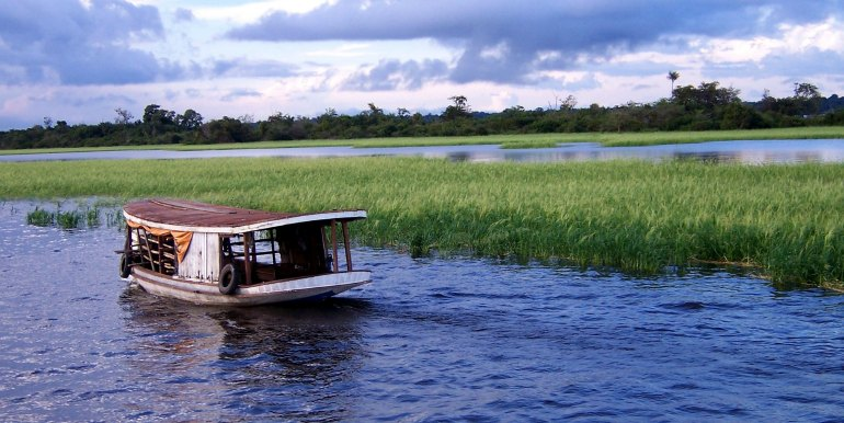 Small river boat on the Amazon