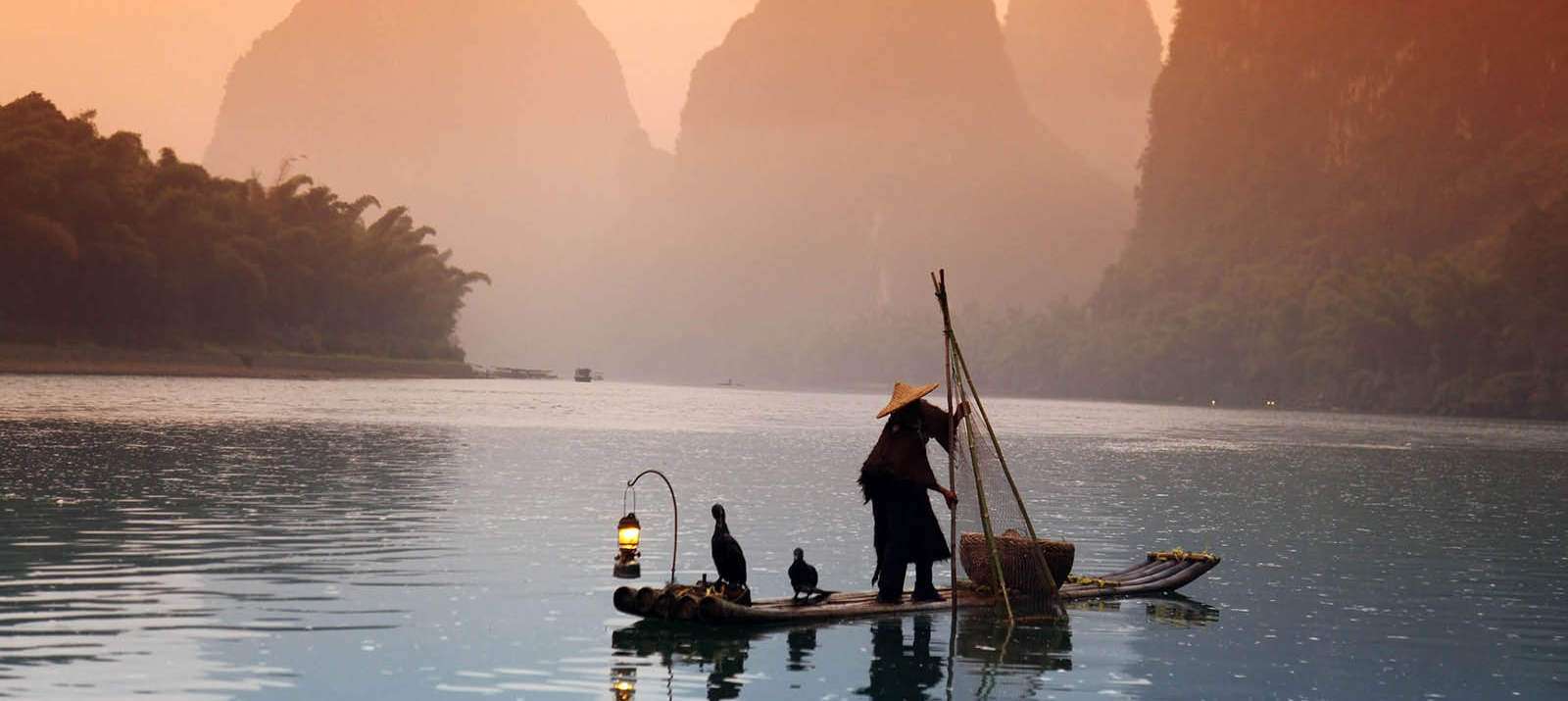 man fishing yangshuo guangxi china