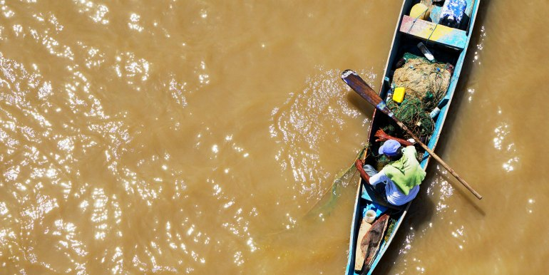 Boat on brown water in the Amazon