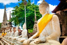 Thai Buddha statues wearing traditional yellow in Ayutthaya, Thailand