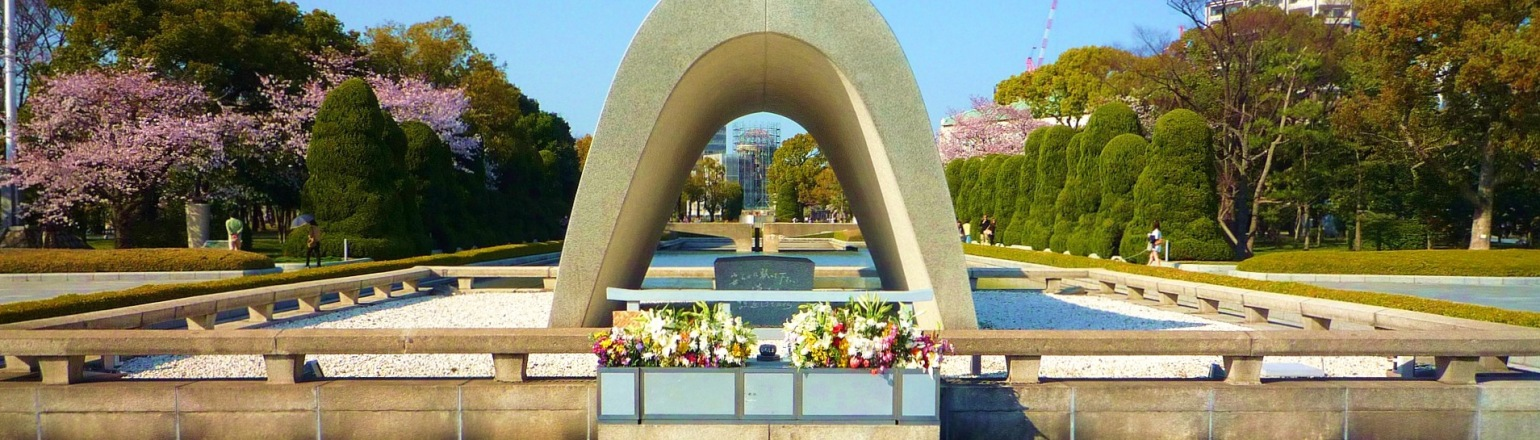 Visiting historical Hiroshima site peace park in Japan on guided tour