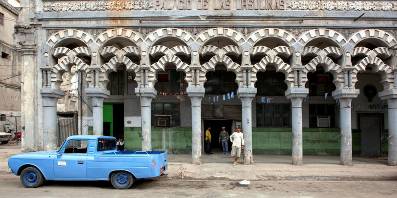 Old building and car in Havana, Cuba