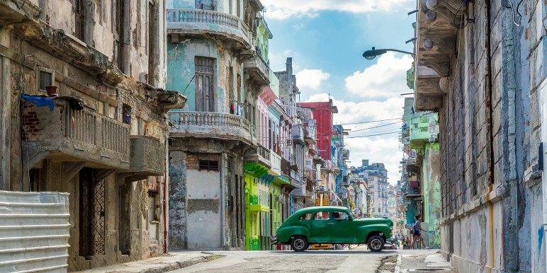 Vintage green car on old street in Havana, Cuba