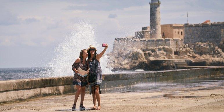 Two young female travelers enjoying a trip to Cuba