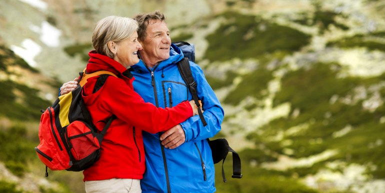 Elderly couple on hiking trip