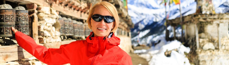 Woman hiker in Himalaya Mountains, Nepal on Peregrine Adventures tour