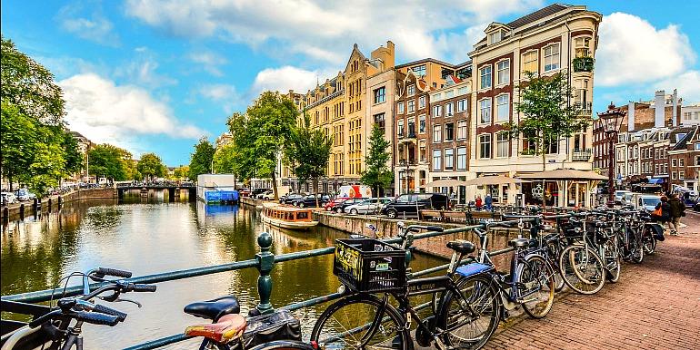 Biking along canals in Amsterdam