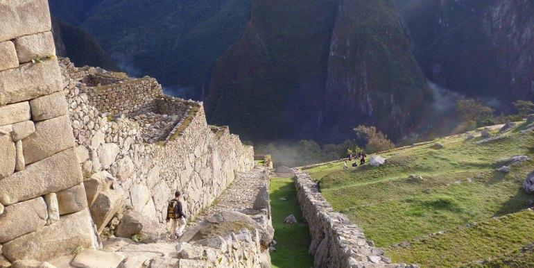 Tourist exploring ruins of Machu Picchu, Peru