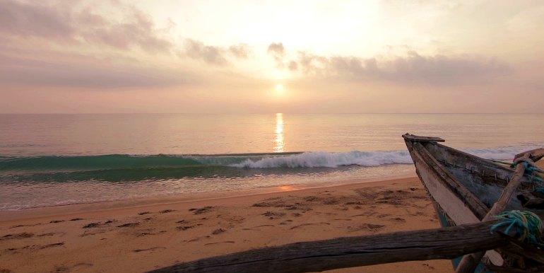 Boat on a beach in Sri Lanka at dusk