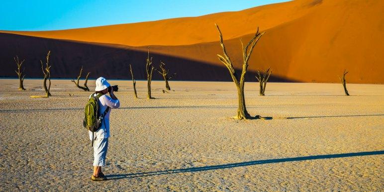 Traveling taking photographs in Namibia