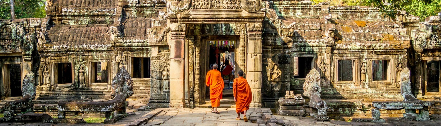 Two Cambodian monks in orange robes at a temple