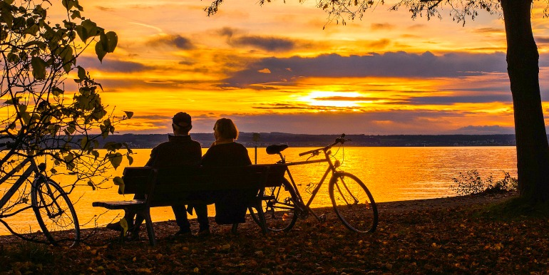 Couple biking at sunset