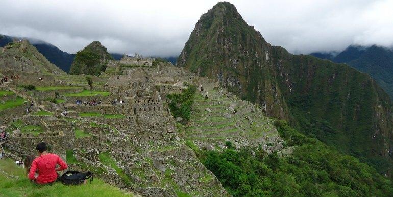 Hiker relaxing over Machu Picchu view