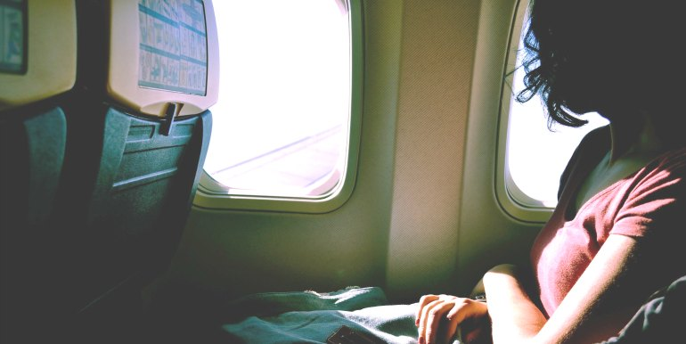 Young woman on flight