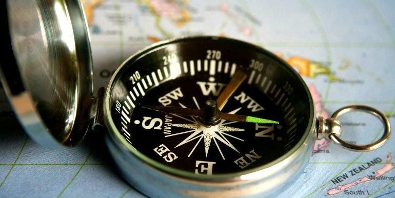 Compass on world map