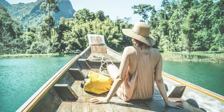 Young woman on boat in Thailand