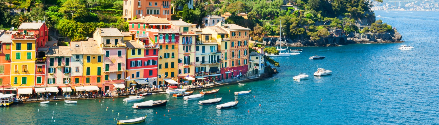 Beautiful colorful houses against the waterfront in Portofino, Italy by Untours