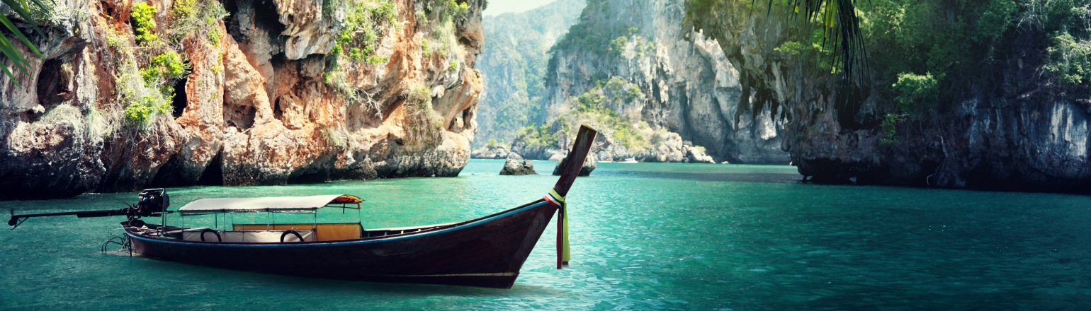 Long boat on beach in Audley Travel Thailand trip