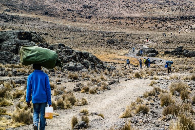 Group of people walking through Kilimanjaro_ Tanzania_P