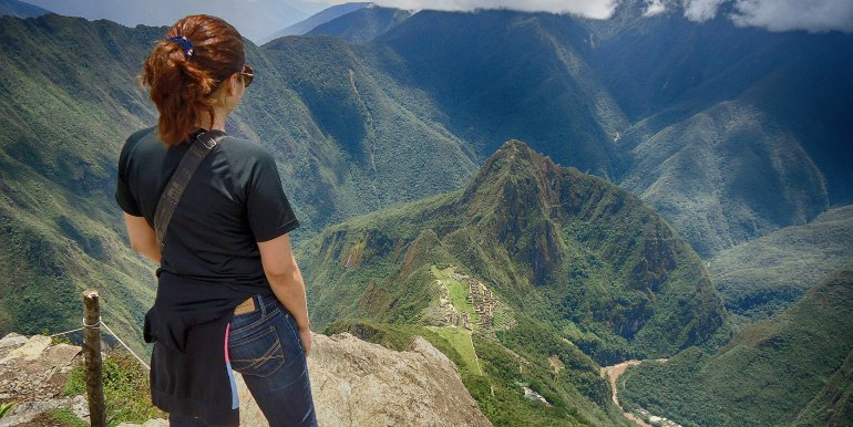 Hiker viewing Machu Picchu from above