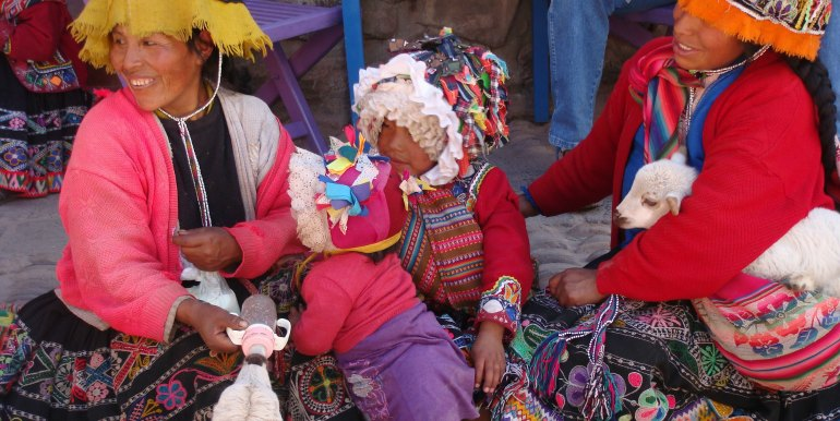 Two women and child in traditional dress, Peru