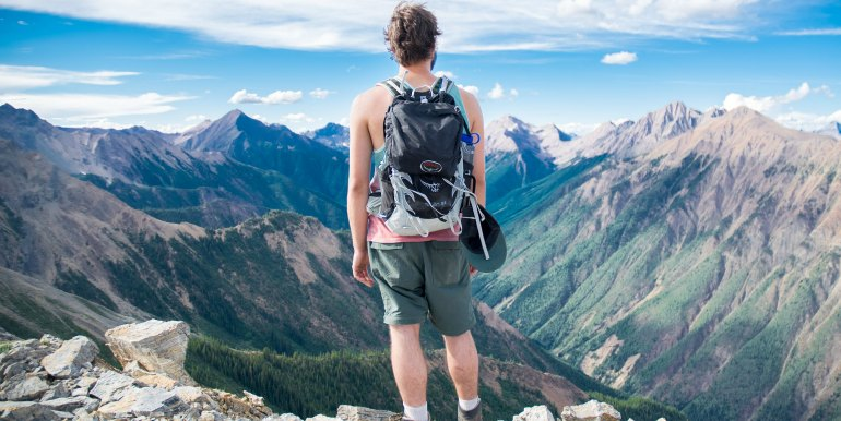 Man on mountain with backpack