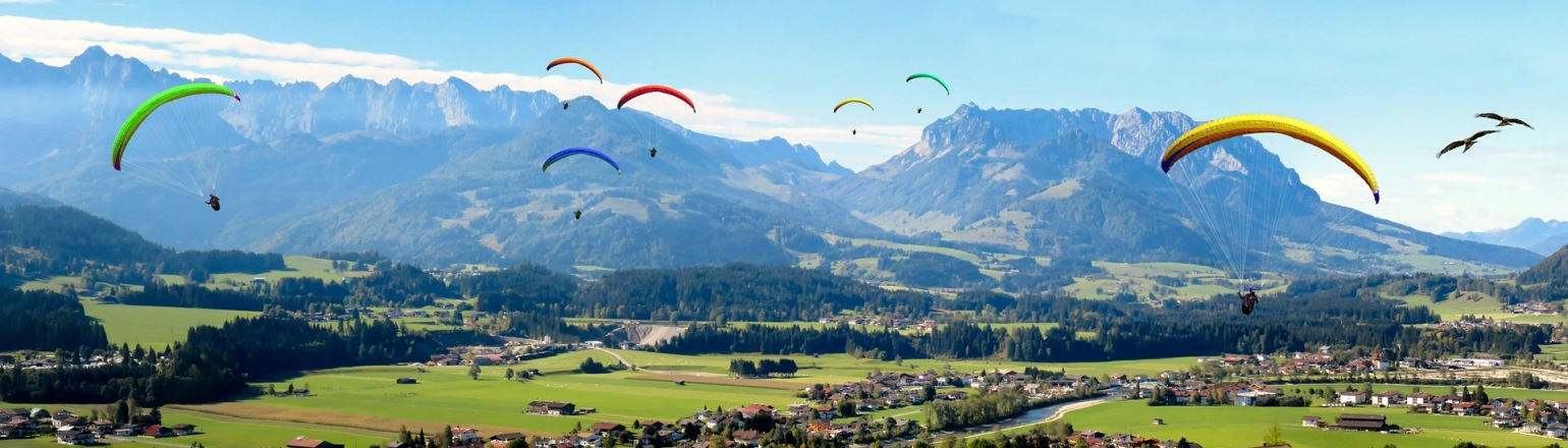 Paragliding in the alps on group high adventure tour