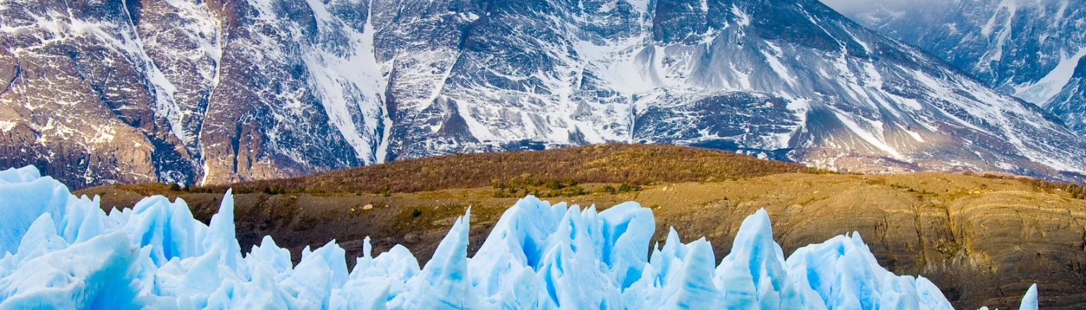 Patagonia tour with bright blue icy glacier formations