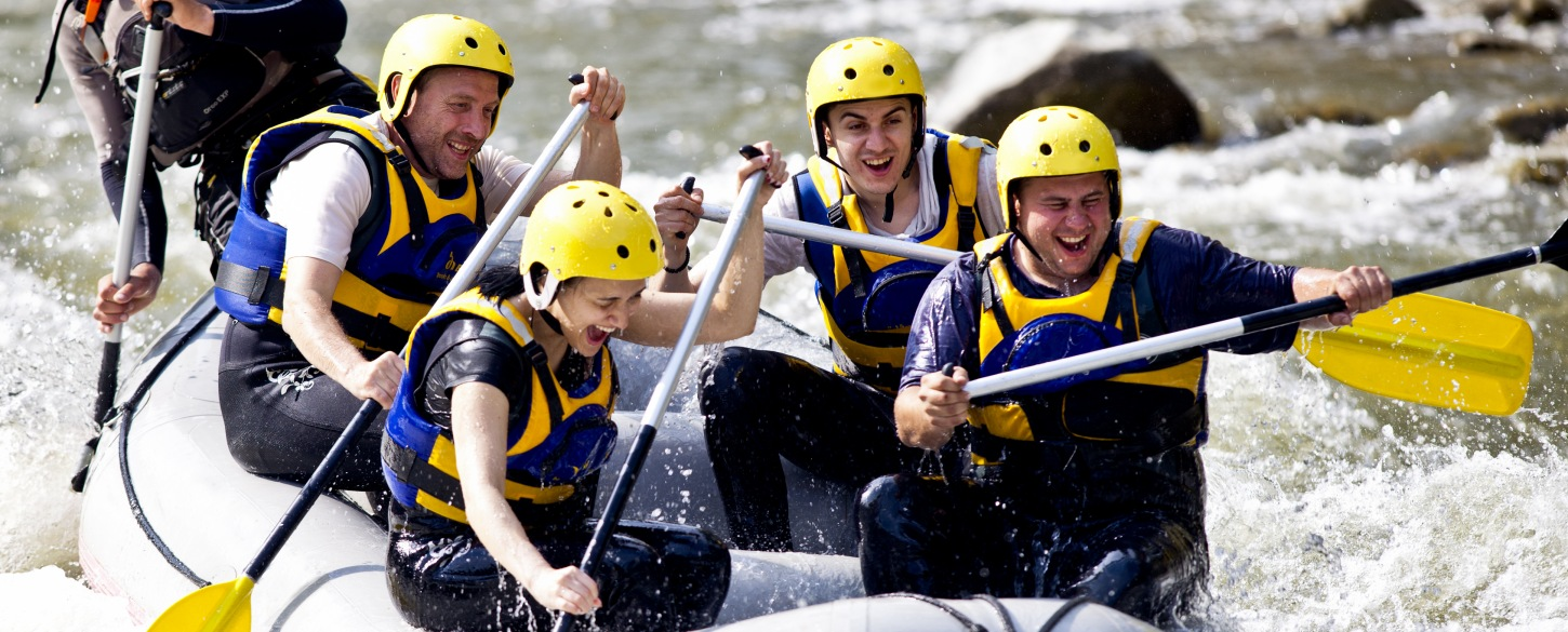 Happy group whitewater rafting in north america adventure trip