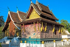 Touring a colorful small temple in Laos