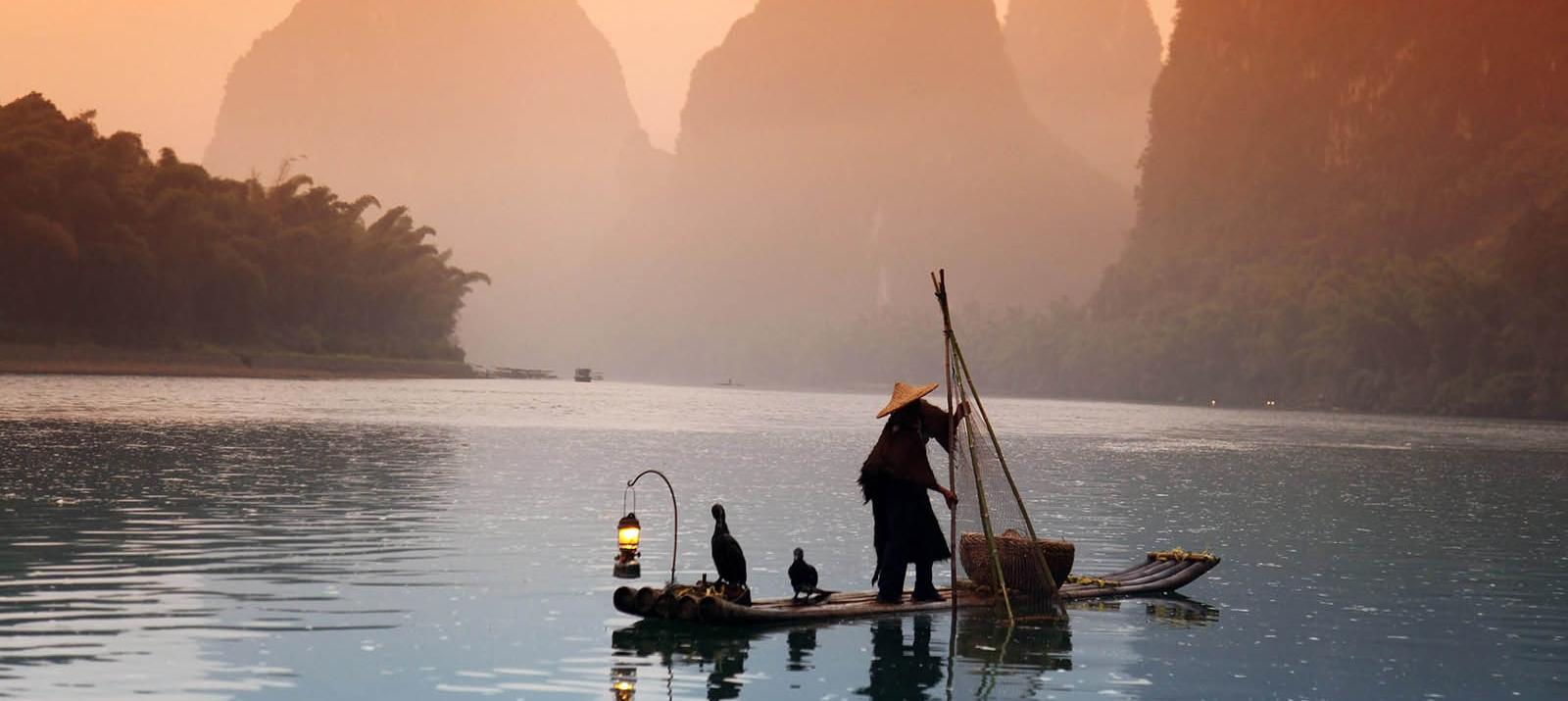 man fishing yangshuo guangxi china