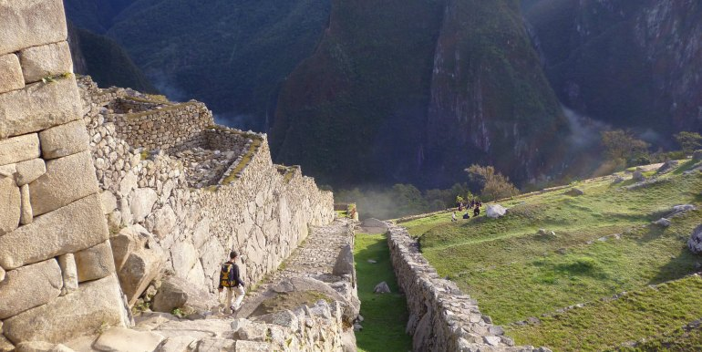 Tourist exploring ruins of Machu Picchu, Peru